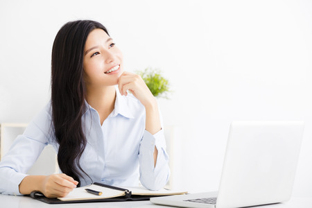 businesswoman thinking while working on computer