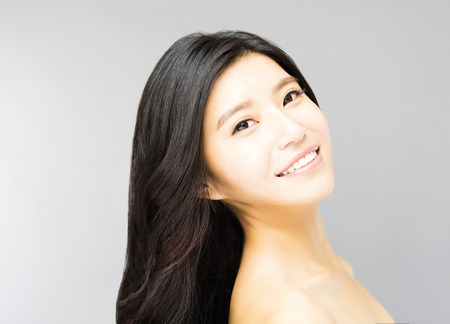 asia women: smiling young Woman with Long and Healthy Black  Hair Stock Photo
