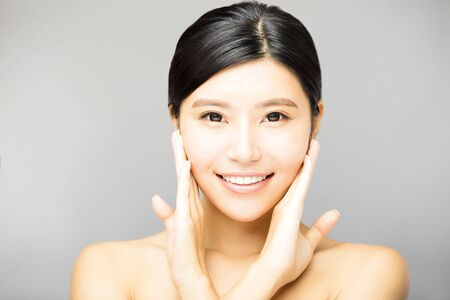 skin care woman: closeup  smiling young  woman face with clean  skin Stock Photo
