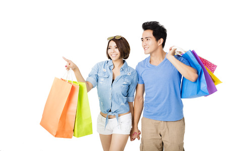 happy shopping: happy young Couple with shopping bags Stock Photo