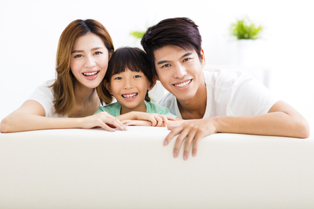 Happy Attractive Young  Family and little girl Stock Photo