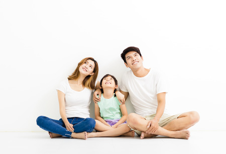girl looking up: Happy Attractive Young  Family looking up