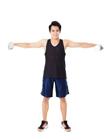 lift hands: smiling young Strong man with dumbbells