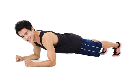body shape: young handsome man doing push up exercise
