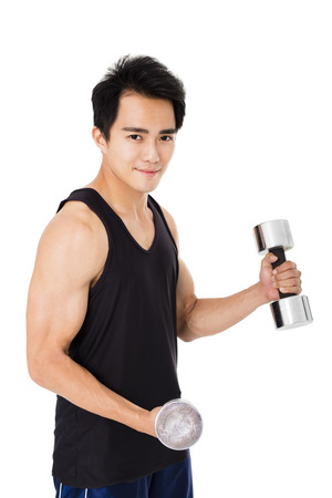 smiling young Strong man with dumbbells