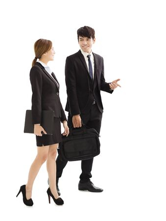asian businesswoman: young business people talking and  walking together Stock Photo