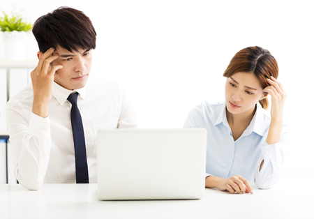 business man  and woman solving problem in office