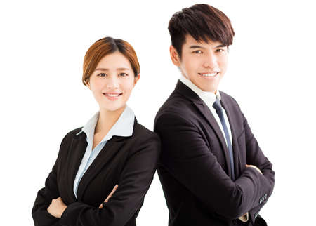 white suit: smiling businesswoman and businessman with crossed arms Stock Photo