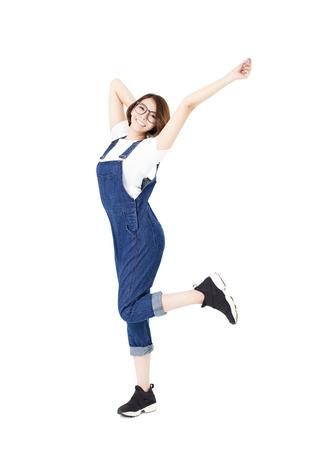 jovenes felices: mujer excitada joven con los brazos extendidos Foto de archivo