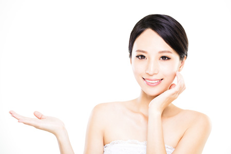 Beautiful young woman showing empty copy space on the open hand palm photo