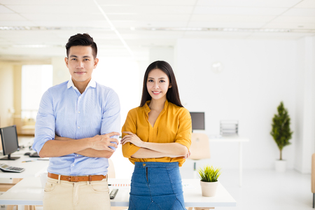 young business man and woman standing in office