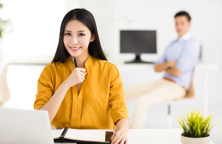 business asia: young beautiful business woman  working in office