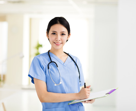 smiling female doctors working in the office Stock Photo