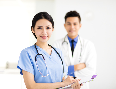 doctors smiling: smiling Medical doctors working in the hospital Stock Photo