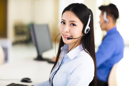Beautiful call center agent working in office Archivio Fotografico