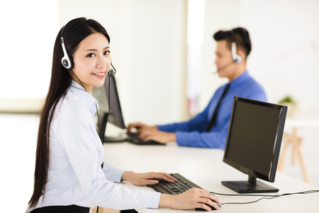 Beautiful call center agent working in office Stock Photo