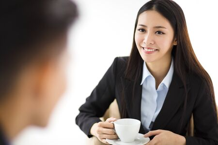 asian businesswoman: businesswoman  drinking coffee and talking with businessman Stock Photo