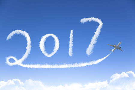holiday destinations: happy New year 2017 drawing by airplane in the sky Stock Photo