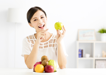 young beautiful woman with healthy fruit