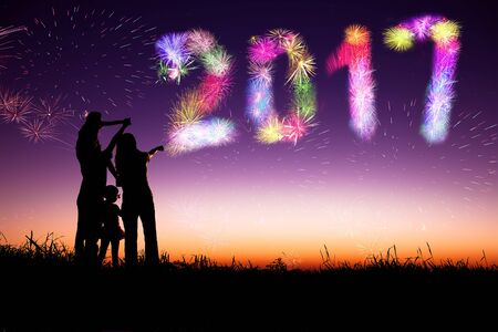 family watching fireworks and happy new year 2017 concept photo