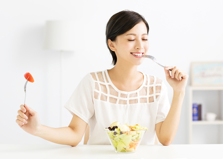 beautiful  young woman eating healthy food Stok Fotoğraf - 62200963