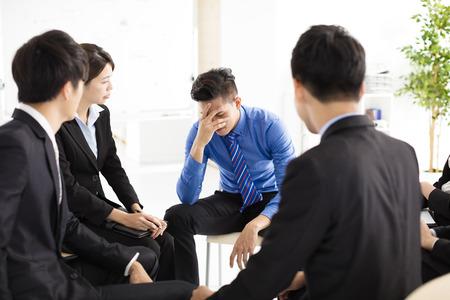 upset: sad and depressed business man  during meeting