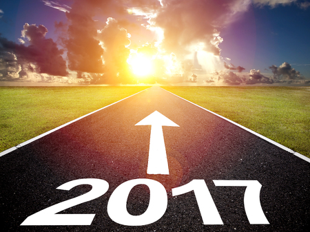 Driving on an empty road and happy new year 2017 concept Stock Photo