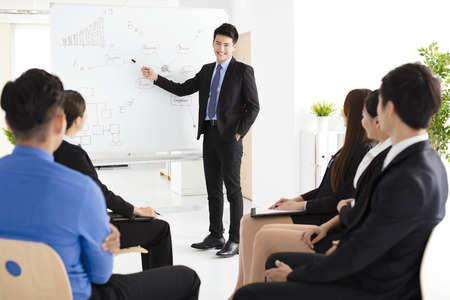 office presentation: Businessman presenting new project to partners in office