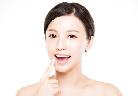 beautiful teeth: beautiful young woman showing her teeth