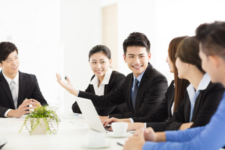 Group of happy young business people in  meeting Imagens - 63240655