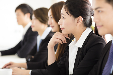 smiling businessman: Group of business people having meeting in office Stock Photo