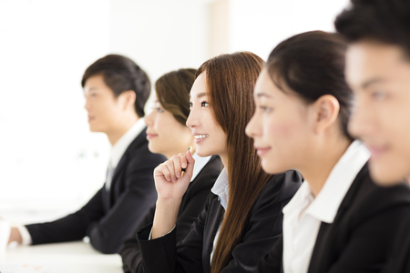 row: Group of business people having meeting in office Stock Photo