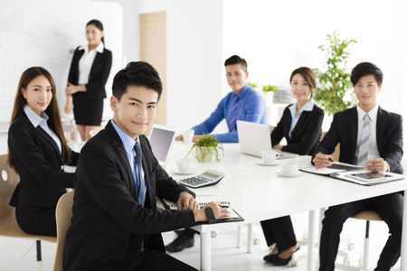 office presentation: Group of happy young business people in  meeting
