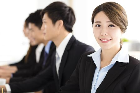 colleague: Smiling businesswoman looking at camera with  colleague