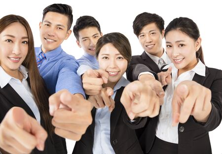 happy worker: Young  Business team with pointing to camera gesture