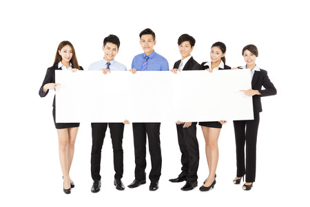 young Business  group holding  blank white  board