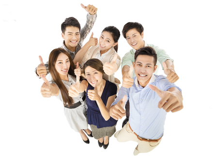 company employee: happy young business team with thumbs up gesture Stock Photo