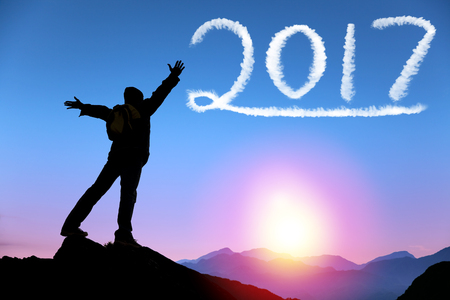 happy new year 2017.man on top of  mountain looking the cloud Stock Photo