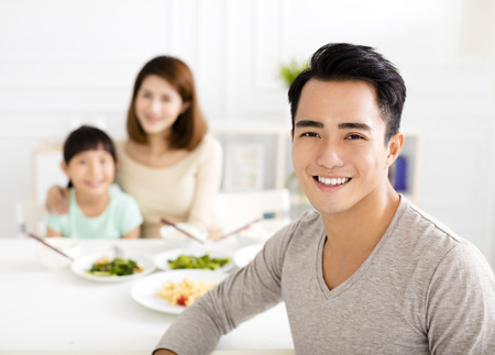 family together: happy asian young Family enjoy their lunch