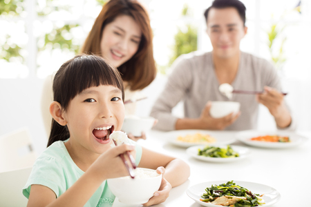 happy young Family enjoy their  dinner