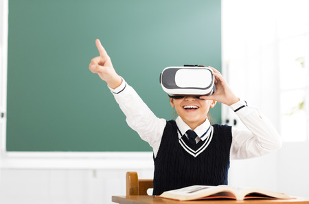student with virtual reality headset sitting in classroom