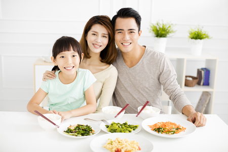 happy asian young Family enjoy their dinner