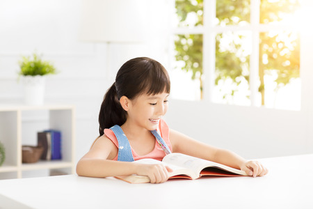 student: happy little girl study in the living room Stock Photo