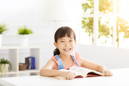 happy little girl study in the living room 版權商用圖片