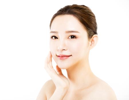 クローズ アップ若い女性の顔が白で隔離 写真素材