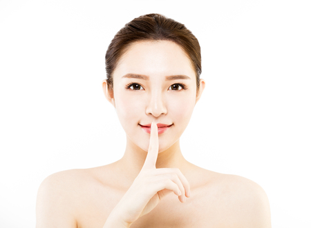 closeup  young   woman  face with quiet gesture Stock Photo
