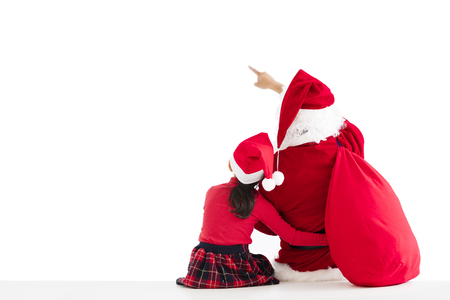 little girl and Santa Claus pointing to white background photo