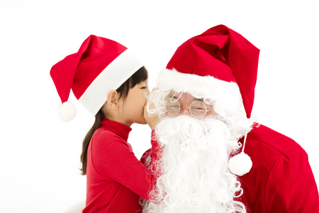 happy Girl telling wish in Santa Claus's ear photo