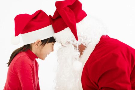 happy Girl looking at Santa Claus's face photo