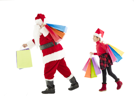 little girl and santa claus holding shopping bags photo